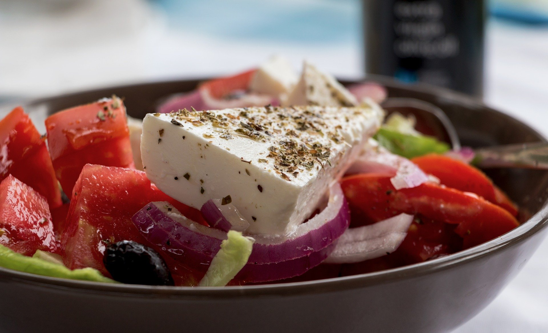 A bowl of marinated vegetables salad with feta